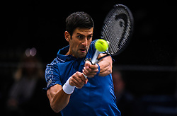 November 1, 2018 - Paris, France - NOVAK DJOKOVIC of Serbia in action against Damir Dzumhur of Bosnia during their match at the Paris Masters. Dzumhur retired in the second set.   (Credit Image: © Panoramic via ZUMA Press)