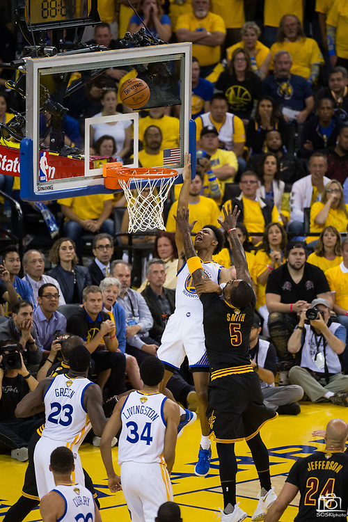 Golden State Warriors forward James Michael McAdoo (20) takes the ball to the basket against Cleveland Cavaliers guard JR Smith (5) during Game 5 of the NBA Finals at Oracle Arena in Oakland, Calif., on June 12, 2017. (Stan Olszewski/Special to S.F. Examiner)