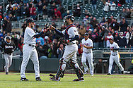 Glen Perkins #15 and Joe Mauer #7 of the Minnesota Twins celebrate after defeating the Miami Marlins in Game 1 of a split doubleheader on April 23, 2013 at Target Field in Minneapolis, Minnesota.  The Twins defeated the Marlins 4 to 3.  Photo: Ben Krause