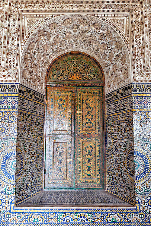 Window with colored tilework and incised plaster inside the Kasbah Telouet in Morocco.