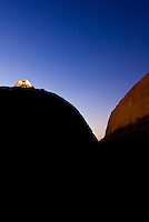 A tent glows at dusk amidst the sandstone features of Canyonlands National Park, Utah.
