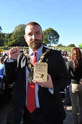 © Copyright licensed to London News Pictures. 06/10/2010. Mayor of Camden, Jonathan Simpson, displays the fabulous winner's trophy of the annual Hampstead Heath conker competition,  Parliament Hill, Hamsptead Heath, London. The Annual Heath Heritage Festival hosts the annual Hampstead Heath Conker Competition. Representatives of the RSPB, National Trust, volunteer group Heath Hands, local beekeepers and woodworkers were in attendance.