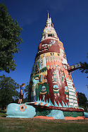 Girl admires towering main totem in Totem Pole Park, Ed Galloway's whimsical collection of concrete totems created in 1948 as a roadside attraction on Route 66 near Claremore, Oklahoma.