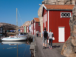 Traditional red wooden buildings in village of Smogen on Swedens Bohuslan coast