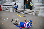 Pro remain campaigner Steve Bray lays on the floor to photograph four rubber yellow hammers on the pavement outside the Cabinet Office in London, United Kingdom on 12th September 2019. Last night the government published details of Operation Yellowhammer which is the codename used by the UK Treasury for cross-government civil contingency planning fin the event of a no-deal Brexit after MPs voted to force its release.