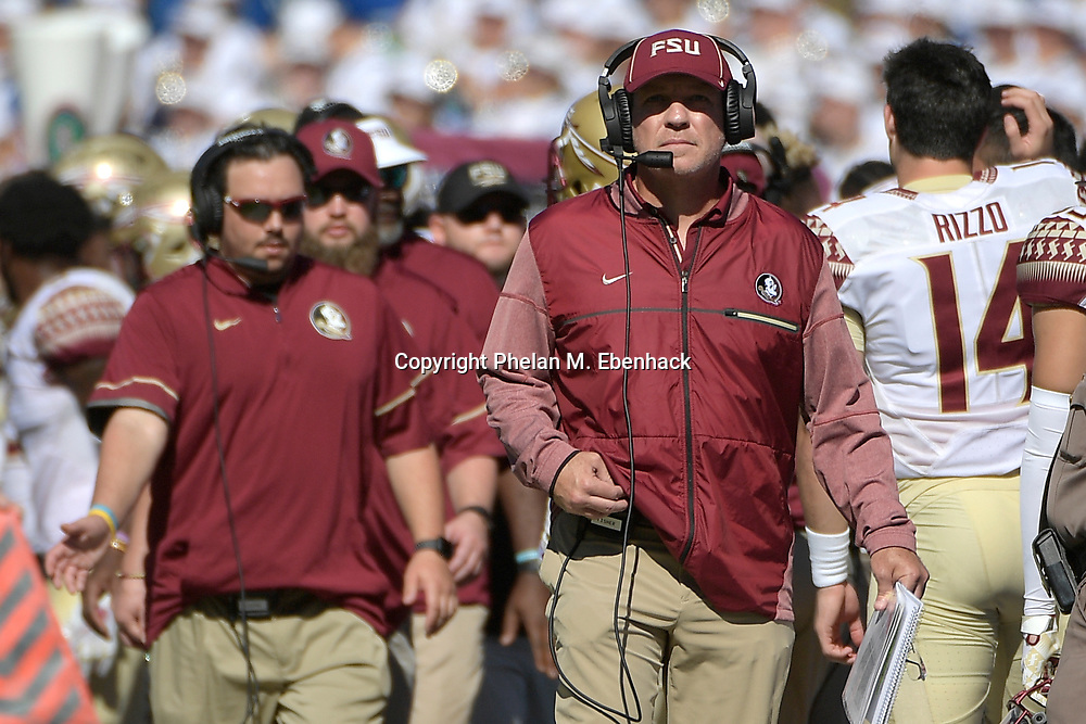 Florida State head coach Jimbo Fisher, right, watches from the sideline during the first half of an NCAA college football game against Florida Saturday, Nov. 25, 2017, in Gainesville, Fla. (Photo by Phelan M. Ebenhack)