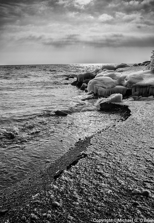 The Earth Water and Sky make a powerful meeting here on the shore of Lake Ontario