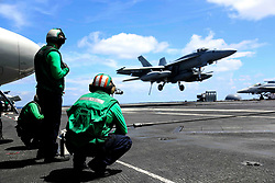 ATLANTIC OCEAN (Aug. 10, 2018) An F/A-18E Super Hornet from the Pukin' Dogs of Strike Fighter Squadron (VFA) 143 prepares to make an arrested landing on the flight deck of the Nimitz-class aircraft carrier USS Abraham Lincoln (CVN 72). (U.S. Navy photo by Mass Communication Specialist 3rd Class Jeff Sherman/Released)180810-N-FQ836-2188