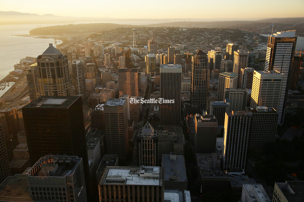 The Seattle skyline at sunset as seen from the 73rd floor of the Columbia Center Sky View Observatory. (Erika Schultz / The Seattle Times)