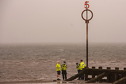 Edinburgh Council continued with the installation of giant numbers at the ends of the groynes on Portobello beach this morning. The numbers, clearly visible from the shore, are intended to make it much easier for visitors to the beach to pinpoint exactly where they are if they need to contact the emergency services for any reason.<br /> © Jon Davey/ EEm