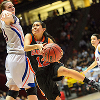 031314  Adron Gardner/Independent<br /> <br /> Gallup Bengal Kaylee Tsinginie (12) maneuvers under Los Lunas Tiger Teige Zeller  (33) during the state high school basketball tournament at The Pit in Albuquerque Thursday.
