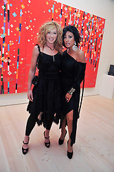 Left to right, KELLY HOPPEN and NANCY DELL'OLIO at an exhibition of photographic portraits by Bryan Adams entitled 'Hear The World' at The Saatchi Gallery, King's Road, London on 21st July 2009.