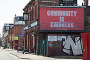 Community is kindness billboard poster in Birmingham city centre eerily quiet and deserted under lockdown due to Coronavirus on 24th April 2020 in Birmingham, England, United Kingdom. Coronavirus or Covid-19 is a new respiratory illness that has not previously been seen in humans. While much or Europe has been placed into lockdown, the UK government has extended stringent rules as part of their long term strategy, and in particular social distancing, which has left usually bustling areas like a ghost town.