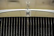 A spirit of ecstacy hood ornament on a Rolls Royce in a showroom in Berkley Square, London.