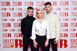 (left to right) Luke Patterson, Grace Chato and Jack Patterson of Clean Bandit attending the Brit Awards 2018 Nominations event held at ITV Studios on Southbank, London.