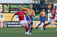 George Lapslie of Charlton Athletic (32) shields the ball away from Neal Bishop of Mansfield Town (6) during the The FA Cup match between Mansfield Town and Charlton Athletic at the One Call Stadium, Mansfield, England on 11 November 2018.