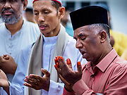 """22 AUGUST 2018 - GEORGE TOWN, PENANG, MALAYSIA: Imams pray before starting the ritual sacrifice of goats during Eid al-Adha services at Kapitan Keling Mosque in George Town. It is the oldest mosque in George Town. Eid al-Adha, """"Feast of the Sacrifice"""" is the second of two Islamic holidays celebrated worldwide each year. It honors the willingness of Ibrahim (Abraham) to sacrifice his son as an act of obedience to God's command.     PHOTO BY JACK KURTZ"""