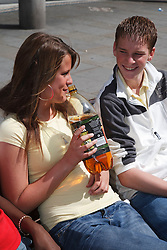 Teenagers drinking.