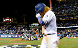 November 1, 2017 - Los Angeles, California, U.S. - Los Angeles Dodgers' Justin Turner walks off the field as the Houston Astros celebrates as they defeat the Los Angeles Dodgers 5-1 in game seven of a World Series baseball game at Dodger Stadium on Nov. 1, 2017 in Los Angeles. (Photo by Keith Birmingham, Pasadena Star-News/SCNG) (Credit Image: © San Gabriel Valley Tribune via ZUMA Wire)