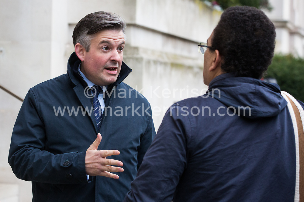 London, UK. 16 November, 2019. Jonathan Ashworth, Shadow Health Secretary, talks talks to a freedom of movement activist from Movement for Justice as he arrives at Labour's Clause V meeting. The Clause V meeting, chaired by the party leader and attended by members of the National Executive Committee (NEC), relevant Shadow Cabinet members and members of the National Policy Forum, will finalise the party's general election manifesto. The meeting is named after Clause V of the Labour Party rulebook.