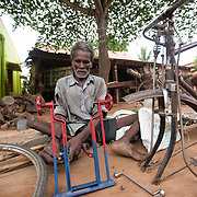 CAPTION: Basavanna has a severe locomotor disability. Loans from the Chamkol programme's Revolving Fund Scheme have helped to ensure that he can support himself through his business of bicycle repairing. LOCATION: Ummathuru (village), Santhemarahalli (hobli), Chamrajnagar (district), Karnataka (state), India. INDIVIDUAL(S) PHOTOGRAPHED: Basavanna.