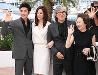 Kim Kang-woo, Kim Hyo-jin, Im Sang-soo, Youn Yuh-jung,  at The Taste of Money photocall at the 65th Cannes Film Festival France. Saturday 26th May 2012 in Cannes Film Festival, France.