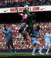 Photo: Olly Greenwood.<br />Arsenal v Manchester City. The FA Barclays Premiership. 25/08/2007. Manchester City's Casper Schmichel saves from Emmanuell Adebayor