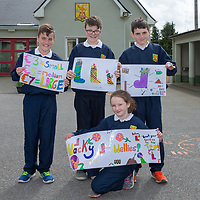 Dylan Bebbington, Ethan Callaghan, Patrick Daly and Aileen McNamara with their posters for their project 'Wacky Wellies'
