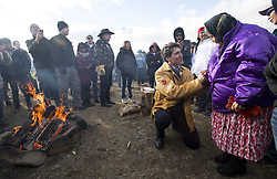 Prime Minister Justin Trudeau greets a elder following a ceremony near Chilko Lake, B.C.,Friday, Nov. 2, 2018. The Prime Minister was in the area to apologize to the Tsilhqot'in community for the hangings of six chiefs during the so-called Chilcotin War over 150 years ago. Photo by The Canadian Press /Jonathan Hayward/ABACAPRESS.COM