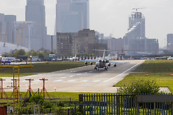 "London City Airport, May 5th 2015. With crosswinds gusting at up to 45 mph, several planes attempting to land at London City Airport have to abort their landings and do a ""go-round"" whilst others endured rough landings.  PICTURED: A passenger jet edures a rough landing, bouncing from its left to right main landing gear."