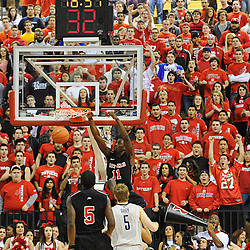 Rutgers Scarlet Knights guard/forward Dane Miller (11) slams home an ally oop dunk during Rutgers' 67-60 upset victory over #8 UConn in NCAA Big East Basketball action at the Louis Brown Athletic Center in Piscataway, N.J. on Jan 7, 2012.