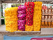 Oct. 9, 2009 -- BANGKOK, THAILAND:  Flower garlands for sale at the Erawan Shrine in Bangkok, Thailand. The Erawan Shrine was built in 1954 to facilitate construction on what was then Bangkok's finest hotel. The shrine is seen as a harbinger of commercial success and is packed with Thais visiting to shrine to pray for material success.  Photo by Jack Kurtz / ZUMA Press