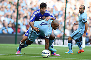 Vincent Kompany of Man city holds off Chelsea's Diego Costa. Barclays premier league match, Manchester city v Chelsea at the Etihad stadium in Manchester,Lancs <br /> pic by Andrew Orchard,