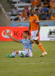 July 18, 2018 - Houston, TX, U.S. - HOUSTON, TX - JULY 18:  Sporting Kansas City midfielder Roger Espinoza (17) gets fouled by Houston Dynamo midfielder Oscar Garcia (27) during the US Open Cup Quarterfinal soccer match between Sporting KC and Houston Dynamo on July 18, 2018 at BBVA Compass Stadium in Houston, Texas. (Photo by Leslie Plaza Johnson/Icon Sportswire) (Credit Image: © Leslie Plaza Johnson/Icon SMI via ZUMA Press)