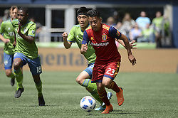 May 26, 2018 - Seattle, Washington, U.S - MLS Soccer 2018: RSL's SEBASTIAN SAUCEDO (23) pushes the ball upfield while KIM KEE-HEE (20) follows as Real Salt Lake visits the Seattle Sounders in a MLS match at Century Link Field in Seattle, WA. (Credit Image: © Jeff Halstead via ZUMA Wire)