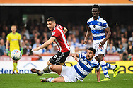 Queens Park Rangers Midfielder Massimo Luongo (21) and Brentford Forward Neal Maupay (9) battle for the ball during the EFL Sky Bet Championship match between Brentford and Queens Park Rangers at Griffin Park, London, England on 21 April 2018. Picture by Stephen Wright.