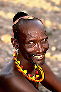 Africa, Kenya, Turkana District in northwest Kenya Turkana tribe Man in traditional dress and decorations. October 2005