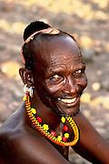 Africa, Kenya, Turkana District in northwest Kenya Turkana tribe Man in traditional dress and decorations. October 2005