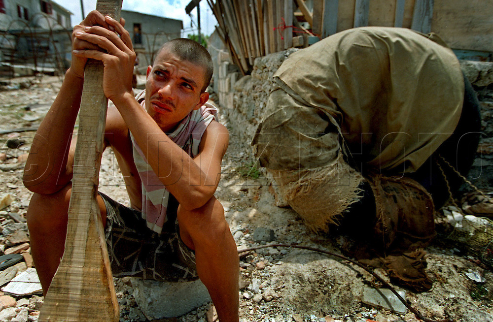 8/1994-Al Diaz/Miami Herald--In 1994 Cuban balseros turned the tiny fishing village of Cojimar into a major point of embarkation for thousands seeking a better life. Here, an unidentified Cuban rests along the shore of Cojimar before departing for the U.S.