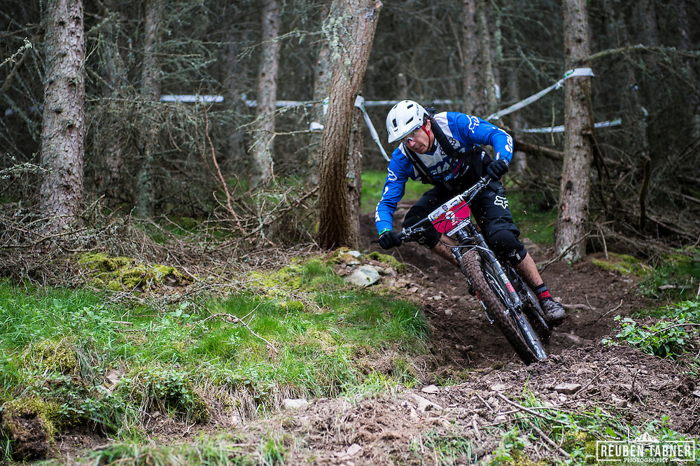 Adam Craig of Giant Factory Off Road Team nips round the trees as he makes his way down stage three during the first day off racing at the World Enduro Series, Tweedlove, Peebles in Scotland.