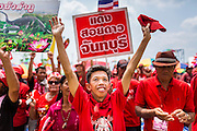 06 APRIL 2014 - BANGKOK, THAILAND: Red Shirt supporters cheer for the government during a rally in the Bangkok suburbs Sunday. Red Shirts and supporters of the government of Yingluck Shinawatra, the Prime Minister of Thailand, gathered in a suburb of Bangkok this weekend to show support for the government. The Thai government is dealing with ongoing protests led by anti-government activists. Legal challenges filed by critics of the government could bring the government down as soon as the end of April. The Red Shirt rally this weekend was to show support for the government, which public opinion polls show still has the support of most of the electorate.   PHOTO BY JACK KURTZ