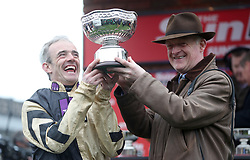 Jockey Ruby Walsh and Trainer Willie Mullins collect the trophy and celebrate their victory in the Sun Bets Stayers' Hurdle during St Patrick's Thursday of the 2017 Cheltenham Festival at Cheltenham Racecourse.