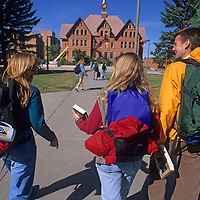 Students at Montana State University in Bozeman walk across campus towards Montana Hall.