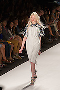 A white dip hem halter dress over a half-sleeve floal print blouse in gray, white and blue with a Peter Pan collar.