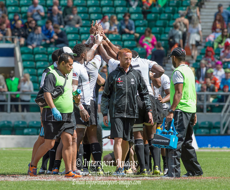 Twickenham, Great Britain,  Fiji Head coach ben RYAN [centre] walks away from the team, after having the last word with them, before the start of the Cup, Semi final, Marriott London Sevens played at the  RFU Stadium, Twickenham, ENGLAND. Sunday 17.05.2015<br /> [Mandatory Credit; Peter Spurrier/Intersport-images]