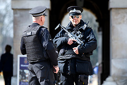 © Licensed to London News Pictures. 22/03/2016. London, UK. Armed police patrolling at Horse Guards Parade on Whitehall in London following the Brussels terror attacks on Tuesday, 22 March 2016. Photo credit: Tolga Akmen/LNP