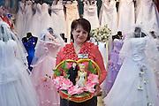 Kaluga, Russia, 31/03/2006..Svetlana Nikolskaya in her Wedding Fashion store.