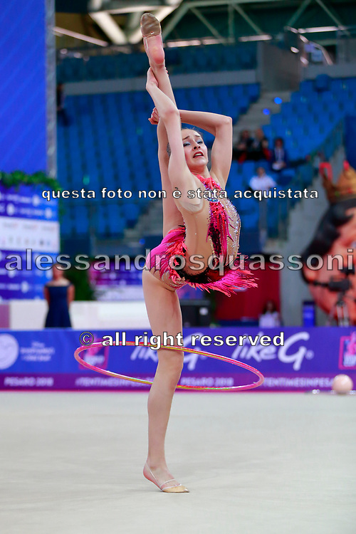 Usmanova Nurinisso during qualification at the hoop in Pesaro World Cup in 2018. Nurinisso was born in Uzbekistan Samarkand region in 2000.
