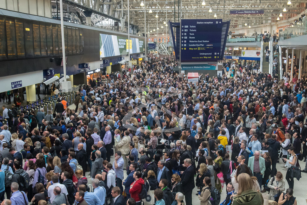 Waterloo Station, London, June 23rd 2016. Commuters face severe delays at London's Waterloo Station as bad weather causes power failures across the rail network. PICTURED: The concourse of Waterloo station packed with commuters.