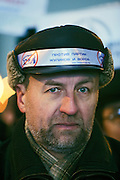 """Moscow, Russia, 24/12/2011..A protestor wears a headband that reads """"Against the party of swindlers and thieves"""", the opposition term for Vladimir Putin's United Russia party.  An estimated crowd of up to 100,000 protested against election fraud and Prime Minister Vladimir Putin in the largest anti-government demonstration in Russia since the collapse of the Soviet Union."""